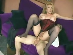 Glamour mature shemale in corset makes dude cum