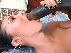 Sexy brunette ts enjoys two dildos in her mouth and ass