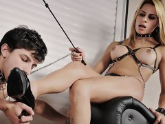Kinky shemale dominatrix Iasmym Rios has her slave boy doing everything she commands or else. Watch as this sexy and oh so kinky shemale domme spanks