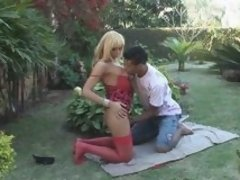 Sultry blonde t-girl in red going for butt plowing right in the back yard